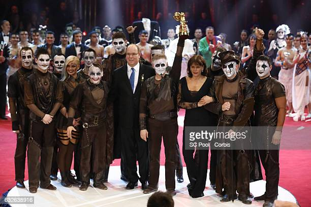 Prince Albert II of Monaco and Princess Stephanie pose with artist of the 'Trushin troop' winner of a Golden Clown award at the awards ceremony of...