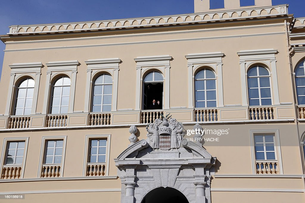 Prince Albert II of Monaco appears on the balcony of the prince's palace during the Sainte-Devote festivities, on January 27, 2013, in Monaco. Saint Devote is the patron saint of the Grimaldi family, reigning in Monaco, and is celebrated each year as a national holiday. AFP PHOTO / VALERY HACHE