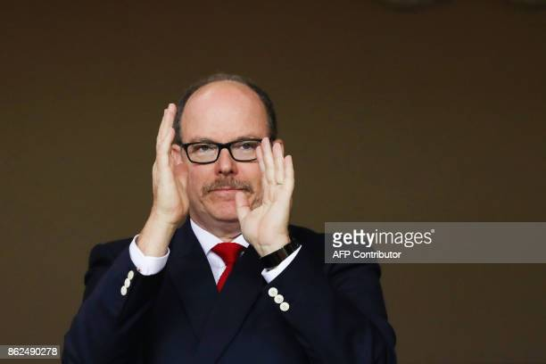 Prince Albert II of Monaco applauds prior to the start of the UEFA Champions League group stage football match between Monaco and Besiktas on October...