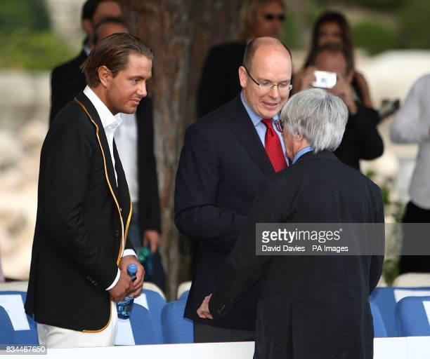 Prince Albert II of Monaco chats to Bernie Ecclestone at the Grand Prix and Fashion Unite at The Amber Lounge Le Meridien Beach Plaza Hotel Monaco