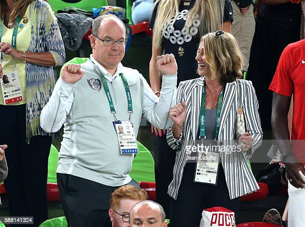 Prince Albert II of Monaco dancing in the stands Nadia Comaneci laughing attend the women's team final in Artistic Gymnastics at Rio Olympic Arena on...