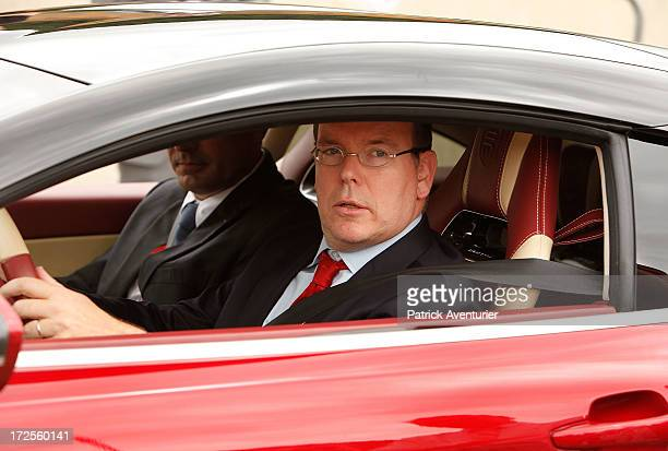Prince Albert II of Monaco drives a French electrique supercar Exagon at the RIVE 2013 on July 3 2013 in Ales France RIVE is the international salon...