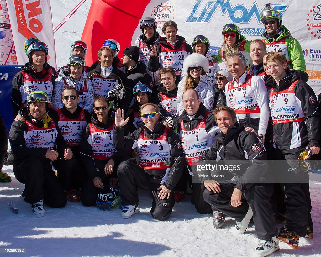 Prince Albert II of Monaco (L), ex Miss Italy Cristina Chiabotto, Prince Emmanuel-Philibert of Savoy (R) and ex Formula One pilot Ricardo Patrese attend the Biatlhon Charity Ski Race To Collect Donations For 'Star Team For The Children MC' on March 2, 2013 in Limone, Italy.