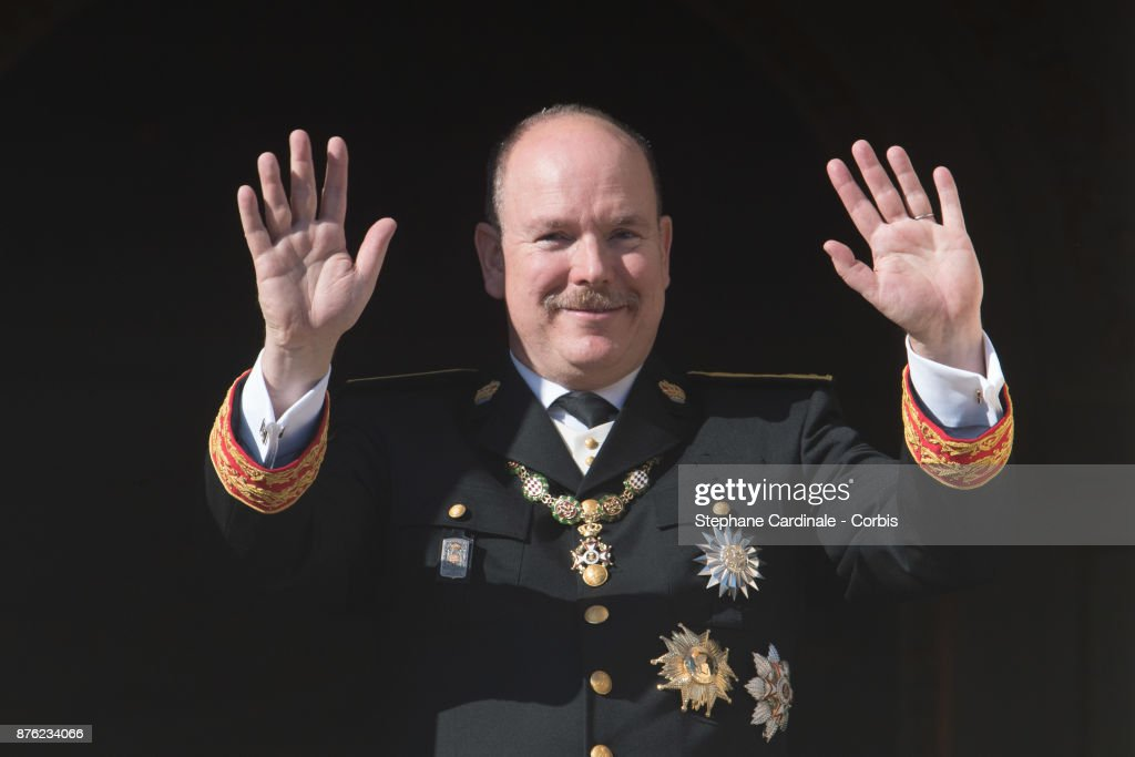 Prince Albert II of Monaco greet the crowd from the Palace's balcony during the Monaco National Day Celebrations on November 19, 2017 in Monaco, Monaco.