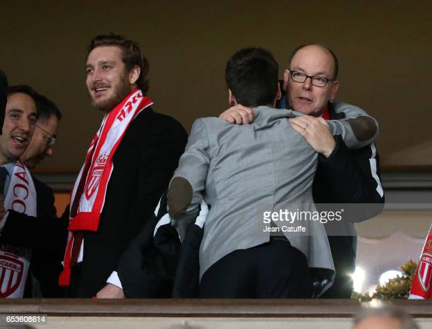 Prince Albert II of Monaco greets Louis Ducruet while Pierre Casiraghi smiles following the UEFA Champions League Round of 16 second leg match...