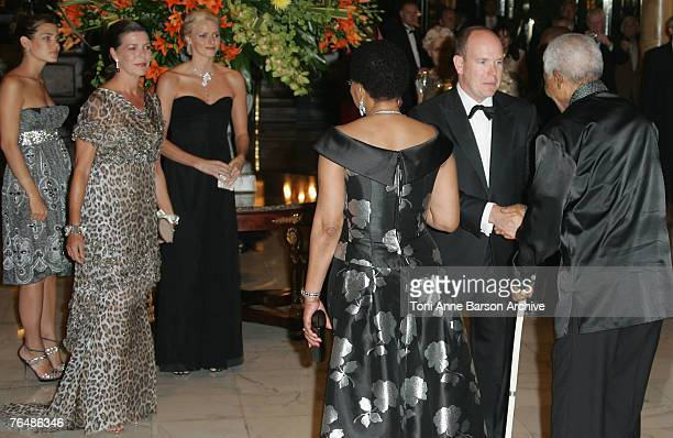 Prince Albert II of Monaco greets Nelson Mandela as Charlotte Casiraghi Princess Caroline of Hanover and Charlene Wittstock look on at the 'Unite For...
