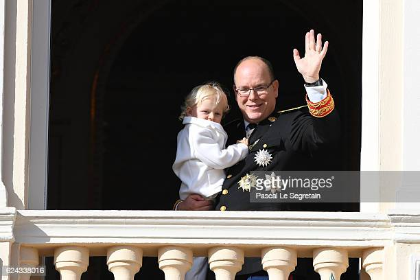 Prince Albert II of Monaco greets the crowd from the palace's balcony with his son Prince Jacques of Monaco during the Monaco National Day...