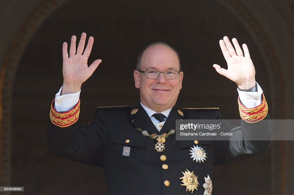 Prince Albert II of Monaco greets the crowd from the palace's balcony during the Monaco National Day Celebrations on November 19, 2016 in Monaco, Monaco.
