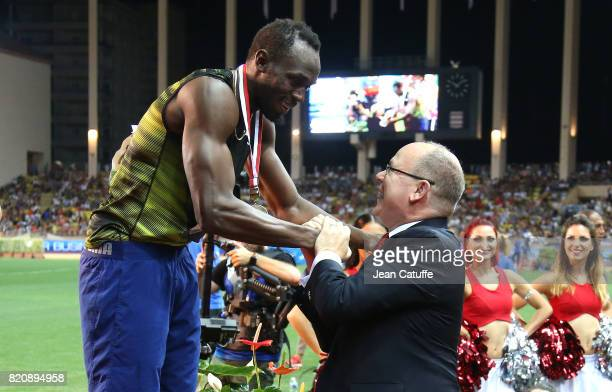 Prince Albert II of Monaco greets Usain Bolt of Jamaica after his victory in his last 100m in a meeting during the IAAF Diamond League Meeting...
