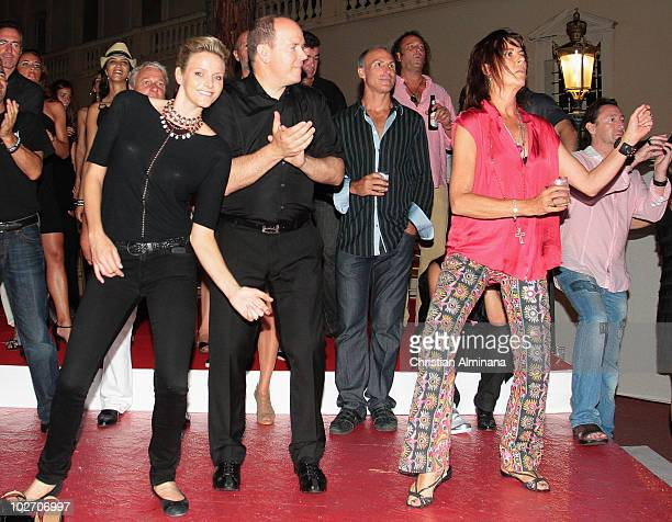 Prince Albert II of Monaco his fiancee Charlene Wittstock of South Africa and Princess Caroline of Monaco dance as they attend concerts of Iggy Pop...