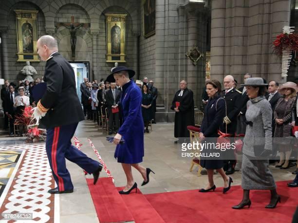 Prince Albert II of Monaco his wife Princess Charlene of Monaco Princess Stephanie of Monaco and Princess Caroline of Hanover attend a mass at the...