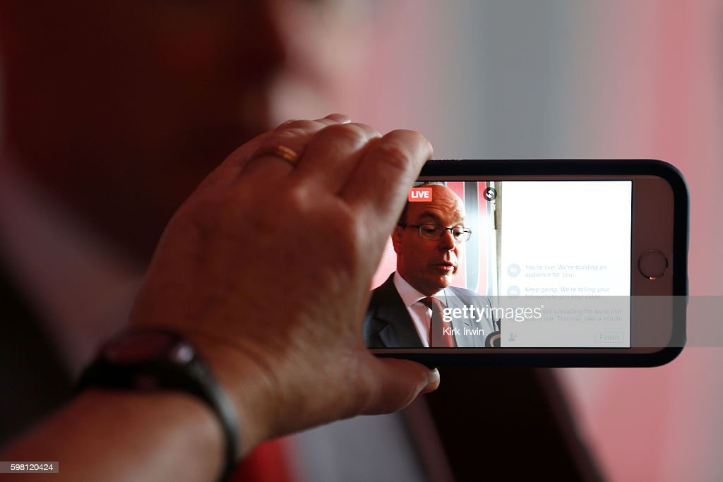 H Prince Albert II of Monaco is recorded on an iPhone while meeting with reporters at Ohio Stadium prior to giving a speech on climate change at Ohio...