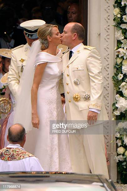 Prince Albert II of Monaco kisses Princess Charlene of Monaco as they leave the Sainte Devote's Church after their religious wedding on July 2 2011...