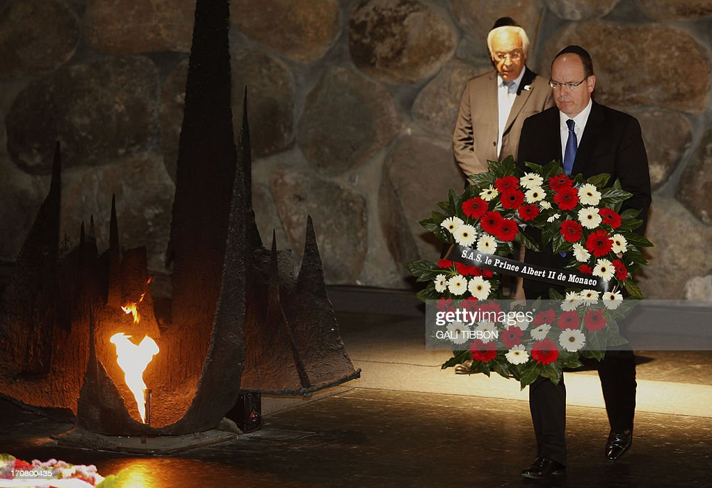 Prince Albert II of Monaco lays a wreath at the Hall of Remembrance on June 18, 2013 during his visit to the Yad Vashem Holocaust Memorial museum in Jerusalem commemorating the six million Jews killed by the Nazis during World War II.