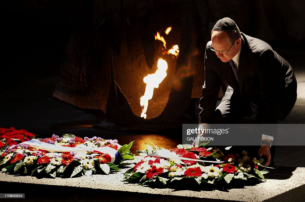 Prince Albert II of Monaco lays a wreath at the Hall of Remembrance on June 18, 2013 during his visit to the Yad Vashem Holocaust Memorial museum in Jerusalem commemorating the six million Jews killed by the Nazis during World War II. AFP PHOTO/GALI TIBBON