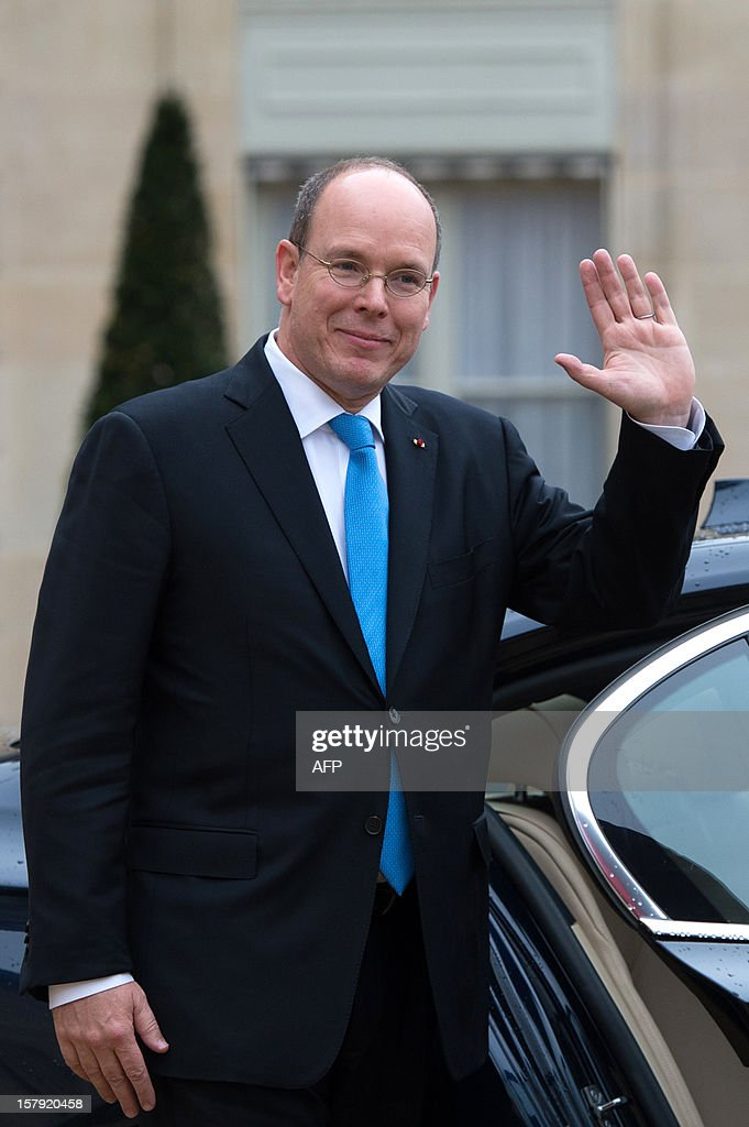 Prince Albert II of Monaco leaves after a lunch with France's President Francois Hollande at the Elysee presidential palace in Paris on December 7, 2012.