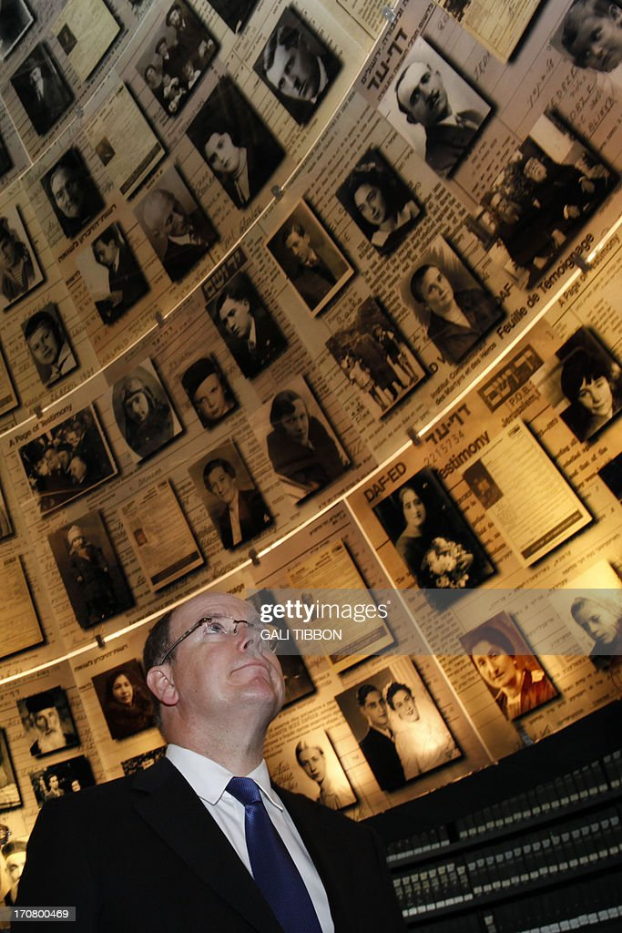 Prince Albert II of Monaco looks at pictures of Jewish Holocaust victims at the Hall of Names on June 18, 2013 during his visit to the Yad Vashem Holocaust Memorial museum in Jerusalem commemorating the six million Jews killed by the Nazis during World War II.