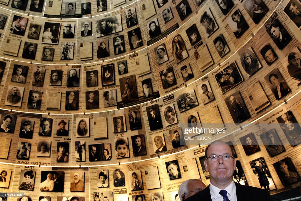 Prince Albert II of Monaco looks at pictures of Jewish Holocaust victims at the Hall of Names on June 18, 2013 during his visit to the Yad Vashem Holocaust Memorial museum in Jerusalem commemorating the six million Jews killed by the Nazis during World War II. AFP PHOTO/GALI TIBBON