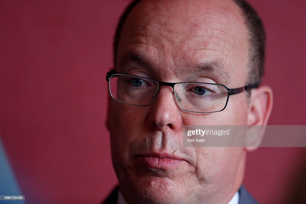 H Prince Albert II of Monaco meets with reporters at Ohio Stadium prior to giving a speech on climate change at Ohio State University on August 31...