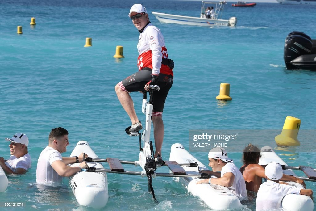 Prince Albert II of Monaco poses prior to compete in the first 'Riviera water bike challenge', a cycling race between Nice and Monaco, in Nice, southeastern France, on June 4, 2017. /