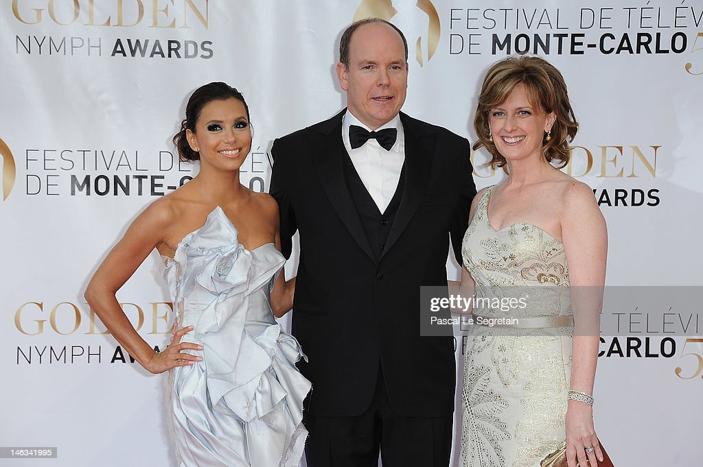 Prince Albert II of Monaco poses with actress Eva Longoria (R) and Anne Sweeney (R) pose as they arrive at the Closing Ceremony of the 52nd Monte Carlo TV Festival on June 14, 2012 in Monte-Carlo, Monaco.