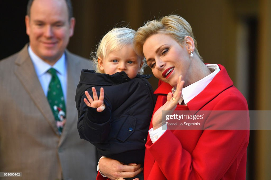 Prince Albert II of Monaco, Prince Jacques of Monaco and Princess Charlene Of Monaco attend the annual Christmas gifts distribution at Monaco Palace on December 14, 2016 in Monaco, Monaco.