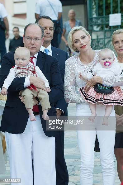 Prince Albert II of Monaco Prince Jacques Princess Charlene of Monaco and Princess Gabriella are welcomed by dancers wearing traditional costumes...