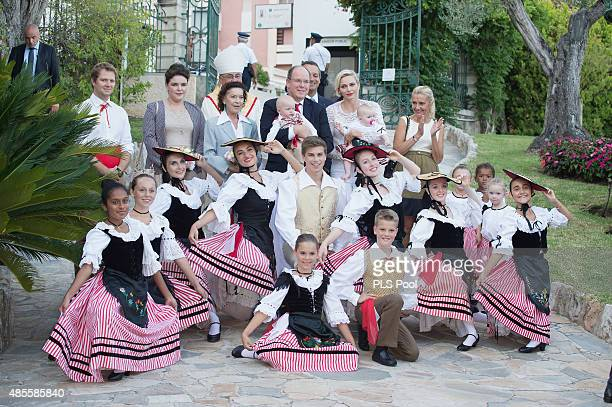 Prince Albert II of Monaco Prince Jacques Princess Charlene of Monaco and Princess Gabriella pose with dancers wearing traditional costumes during...