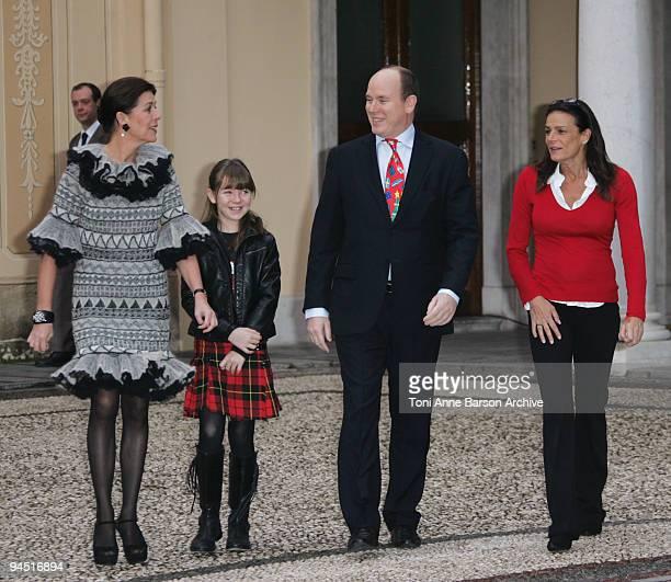 Prince Albert II of Monaco Princess Caroline of Hanover Princess Alexandra of Hanover and Princess Stephanie of Monaco prepare to distribute presents...