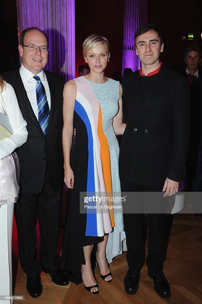 Prince Albert II of Monaco, Princess Charlene of Monaco and fashion designer Raf Simons attend the Dior Cruise Collection 2014 cocktail on May 18, 2013 in Monaco, Monaco.
