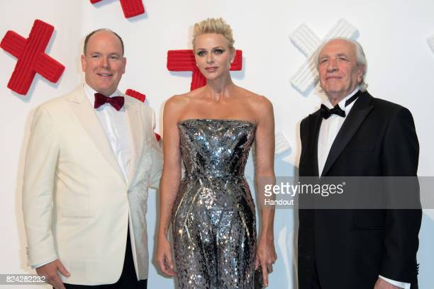 Prince Albert II of Monaco Princess Charlene of Monaco and Pino Pinelli attend the 69th Monaco Red Cross Ball Gala at Sporting MonteCarlo on July 28...