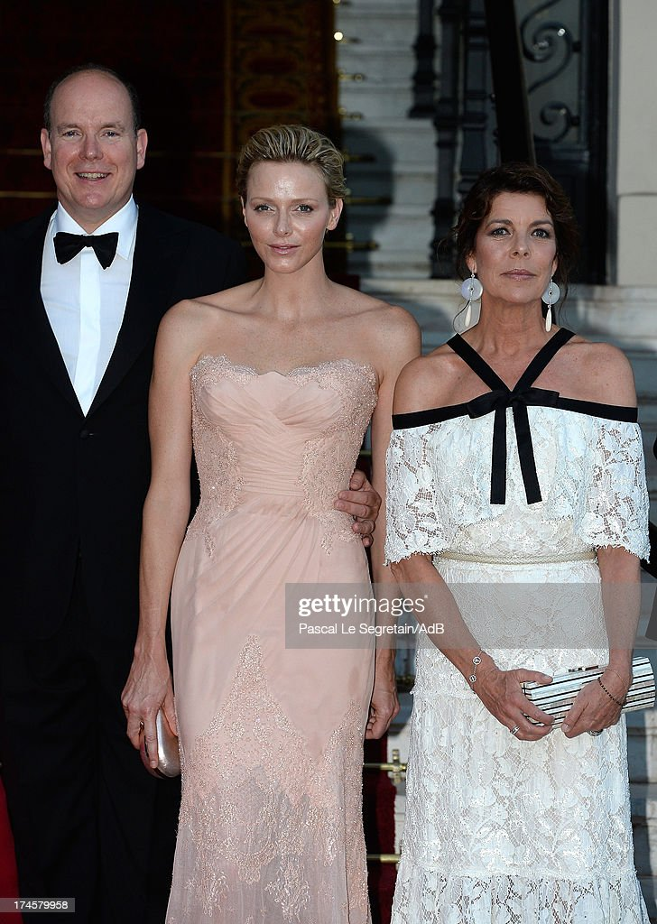 Prince Albert II of Monaco, Princess <a gi-track='captionPersonalityLinkClicked' href=/galleries/search?phrase=Charlene+-+Princesa+de+M%C3%B3naco&family=editorial&specificpeople=726115 ng-click='$event.stopPropagation()'>Charlene</a> of Monaco and Princess Caroline of Hanover arrive at 'Love Ball' hosted by Natalia Vodianova in support of The Naked Heart Foundation at Opera Garnier on July 27, 2013 in Monaco, Monaco.