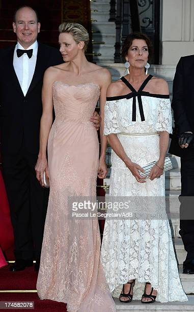Prince Albert II of Monaco Princess Charlene of Monaco and Princess Caroline of Hanover arrive at 'Love Ball' hosted by Natalia Vodianova in support...