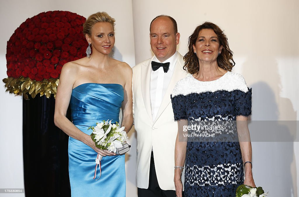 Prince Albert II of Monaco (C) Princess Charlene of Monaco (L) and Princess Caroline of Hanover (R) arrive to attend the 65th annual Red Cross Gala, on August 2, 2013, in Monaco. Created in 1948, the gala is an annual charity event held in Monaco by its Princely Family during the summer.