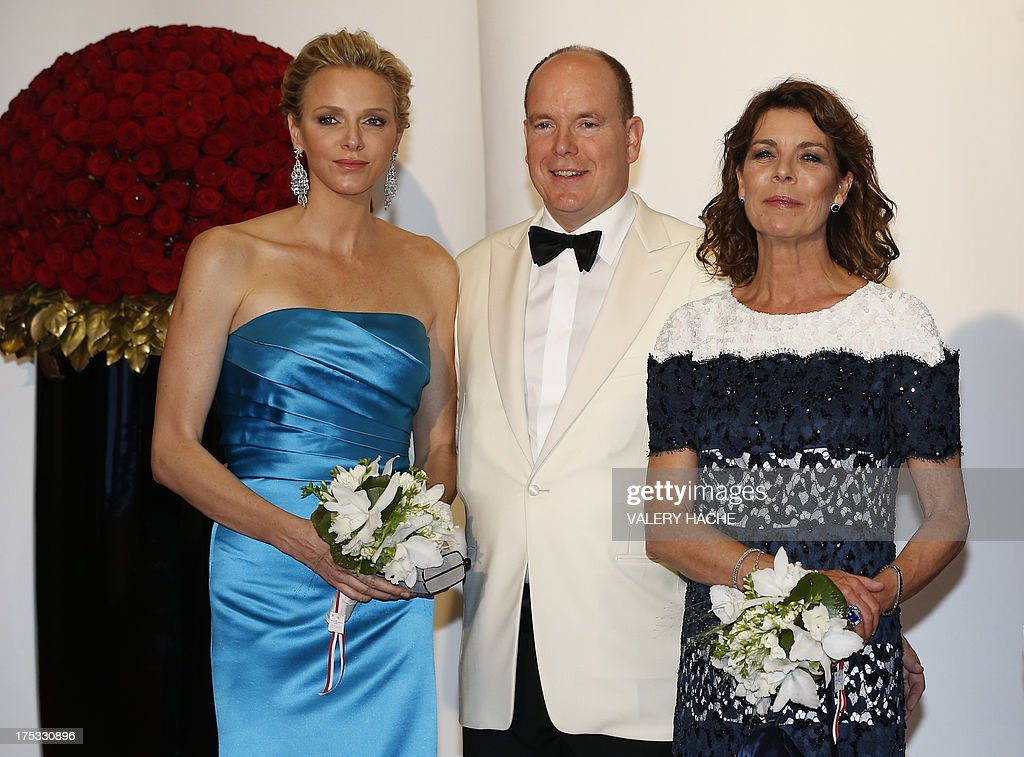 Prince Albert II of Monaco (C) Princess Charlene of Monaco (L) and Princess Caroline of Hanover (R) pose at the 65th annual Red Cross Gala, on August 2, 2013, in Monaco. Created in 1948, the gala is an annual charity event held in Monaco by its Princely Family during the summer.