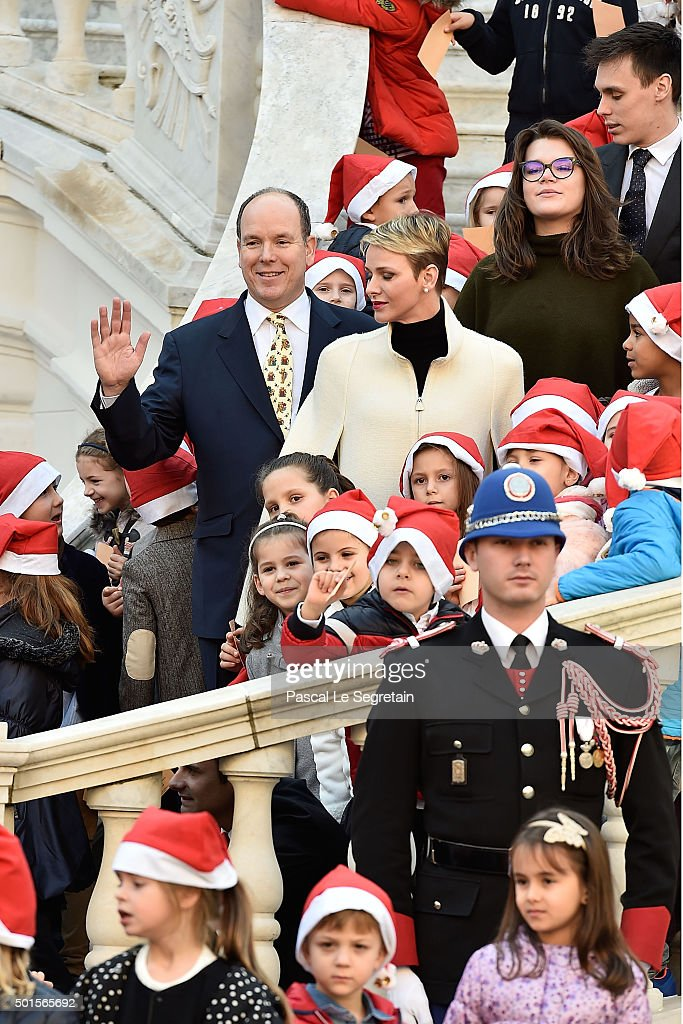 Prince Albert II of Monaco, Princess Charlene of Monaco, Camille Gottlieb and Louis Ducruet attend the Christmas gifts distribution on December 16, 2015 in Monaco, Monaco.