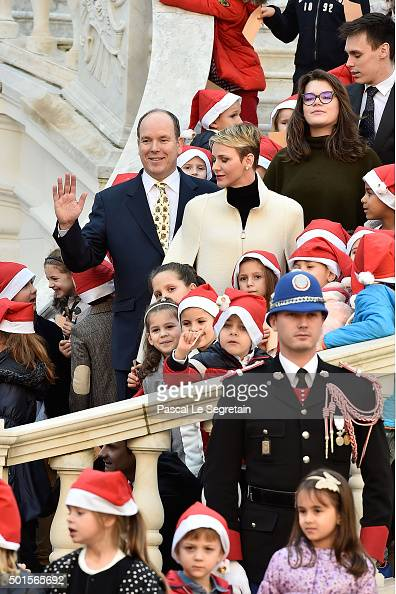 Prince Albert II of Monaco Princess Charlene of Monaco Camille Gottlieb and Louis Ducruet attend the Christmas gifts distribution on December 16 2015...