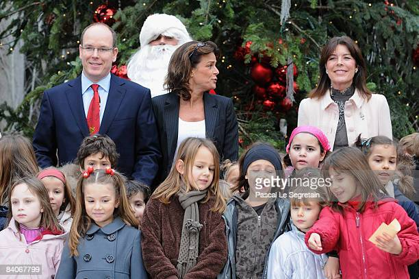 Prince Albert II of Monaco Princess Stephanie of Monaco and Princess Caroline of Hanover pose with children during the Christmas tree Party on...
