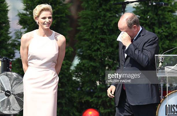 Prince Albert II of Monaco reacts after Princess Charlene of Monaco delivered a speech during celebrations marking Prince Albert II's decade on the...