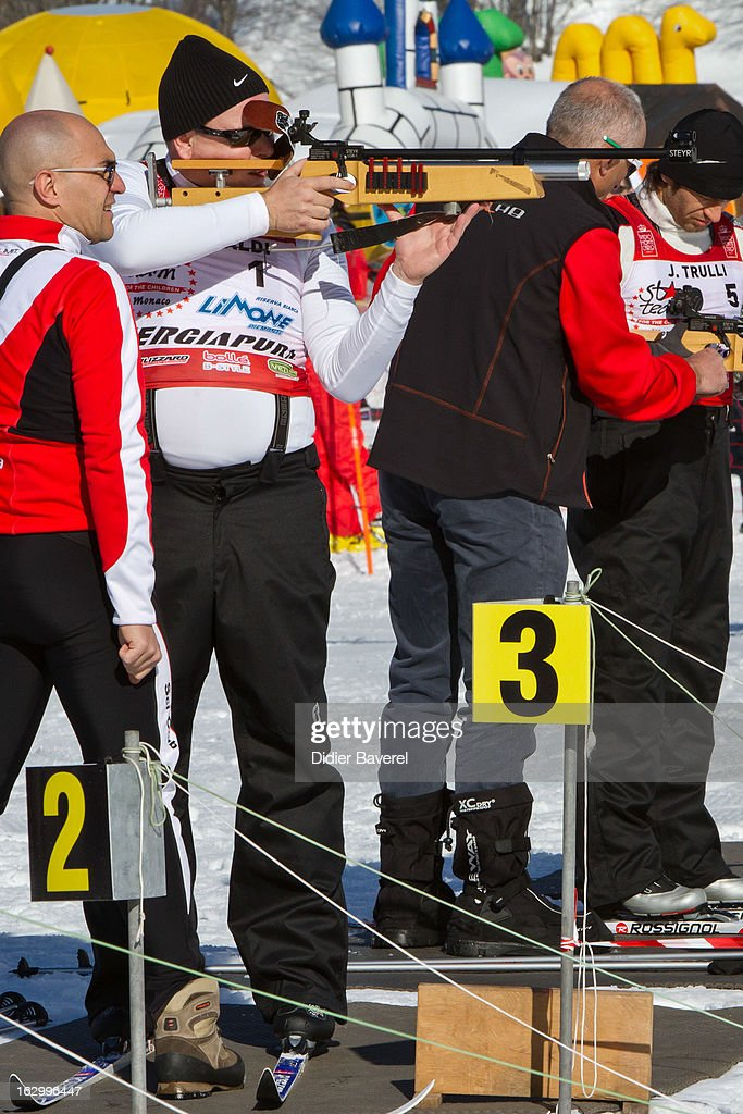 Prince Albert II of Monaco shoots during the Biatlhon Charity Ski Race To Collect Donations For 'Star Team For The Children MC' on March 2, 2013 in Limone, Italy.