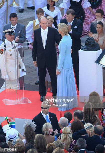 Prince Albert II of Monaco smiles at Princess Charlene of Monaco after the civil ceremony of their Royal Wedding at the Prince's Palace on July 1...