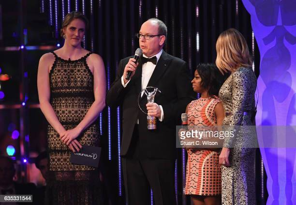 Prince Albert II of Monaco speaks as Gymnast Simone Biles of the US the winner of the Laureus World Sportswoman of the Year Award and Laureus Academy...