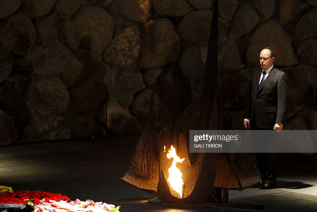 Prince Albert II of Monaco stands after rekindling the eternal flame at the Hall of Remembrance on June 18, 2013 during his visit to the Yad Vashem Holocaust Memorial museum in Jerusalem commemorating the six million Jews killed by the Nazis during World War II.