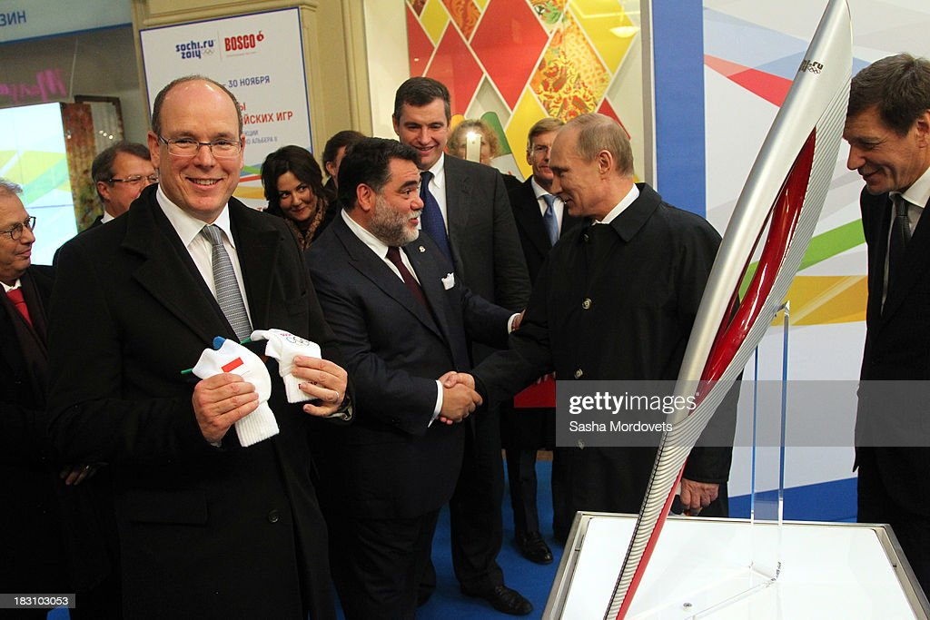 <a gi-track='captionPersonalityLinkClicked' href=/galleries/search?phrase=Prince+Albert+II+of+Monaco&family=editorial&specificpeople=201707 ng-click='$event.stopPropagation()'>Prince Albert II of Monaco</a> (L) visits an exhibition of Olympic torches from his own collection at the GUM department store as GUM owner Mikhail Kusnirovich (C) shakes hands with Russian President <a gi-track='captionPersonalityLinkClicked' href=/galleries/search?phrase=Vladimir+Putin&family=editorial&specificpeople=154896 ng-click='$event.stopPropagation()'>Vladimir Putin</a> (2R) at Red Square October 4, 2013 in Moscow, Russia. Prince Albert II will also be one of the dignitaries to carry the Olympic torch as it begins its four-month journey to Sochi next week.