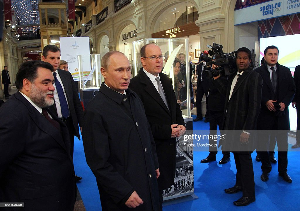 <a gi-track='captionPersonalityLinkClicked' href=/galleries/search?phrase=Prince+Albert+II+of+Monaco&family=editorial&specificpeople=201707 ng-click='$event.stopPropagation()'>Prince Albert II of Monaco</a> (3R) visits an exhibition of Olympic torches from his own collection at the GUM department store with GUM owner Mikhail Kusnirovich (L) and Russian President <a gi-track='captionPersonalityLinkClicked' href=/galleries/search?phrase=Vladimir+Putin&family=editorial&specificpeople=154896 ng-click='$event.stopPropagation()'>Vladimir Putin</a> (3L) at Red Square October 4, 2013 in Moscow, Russia. Prince Albert II will also be one of the dignitaries to carry the Olympic torch as it begins its four-month journey to Sochi next week.