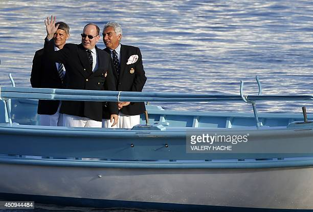 Prince Albert II of Monaco waves as he arrives for the inauguration of the new Yacht Club of Monaco on June 20 2014 in Monaco AFP PHOTO / VALERY HACHE
