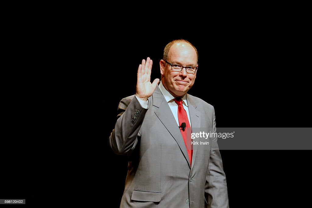 H Prince Albert II of Monaco waves to the crowd after answering questions and giving a speech about climate change and sustainable energy at Mershon...