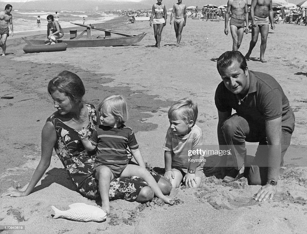 Prince Albert of Belgium, later King Albert II of Belgium and Princess Paola of Belgium (later Queen Paola of Belgium) with their children Princess Astrid of Belgium and Prince Philippe of Belgium (right), enjoying a family holiday on the beach at Forte dei Marmi, Italy,16th August 1964.