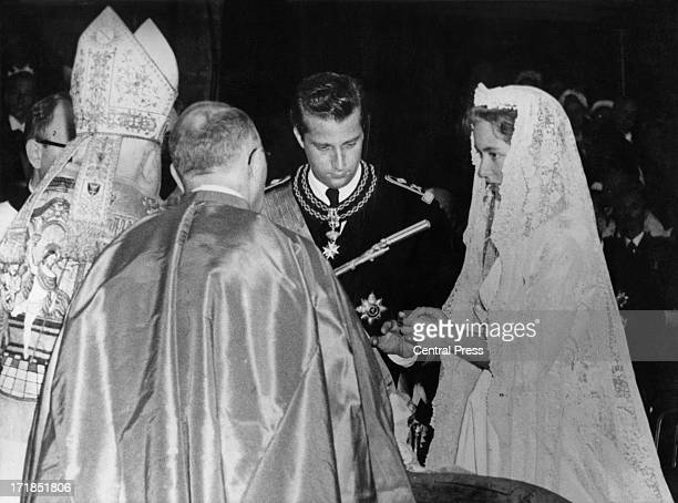Prince Albert of Belgium later King Albert II of Belgium and Princess Paola of Belgium exchange rings at their wedding ceremony being held in the...