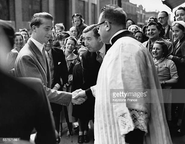 Prince Albert of Belgium shakes hands with the priest after having attended a religious service in a church in Camden Town on May 31 1953 in London...